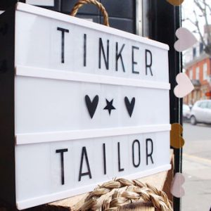 Lightbox in the window of the Tinker Tailor shop in Enfield North London