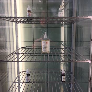 A fridge containing a selection of products from The Ordinary by Deciem