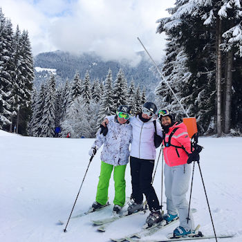Three women on skis half way down Piste B at Morzine
