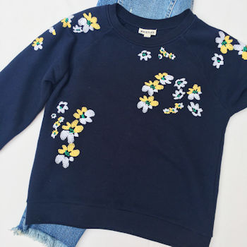 Navy blue sweatshire with white and yellow flowers from Whistles