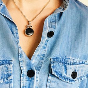 A black pendant necklace worn by Helen Perry, Not About the Kids