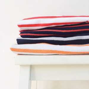 A selection of striped breton tees folded against a white background