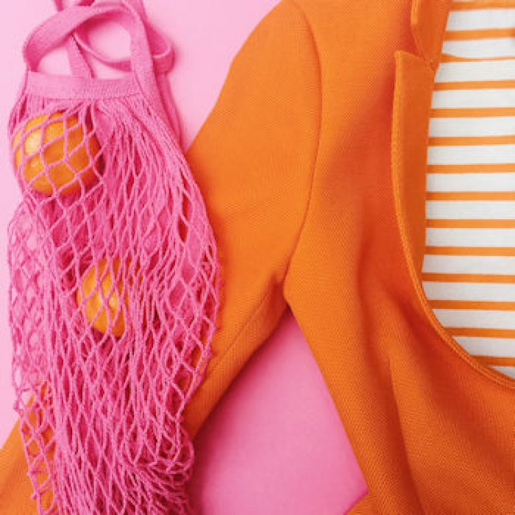orange coat, pink string bag, oranges