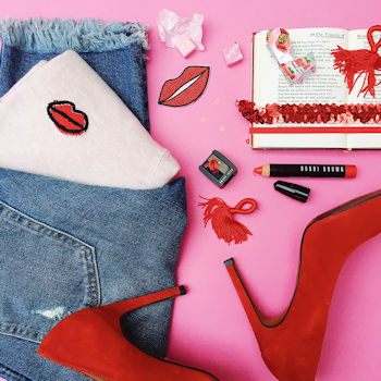 Flat lay, pink and red, red heels, denim jeans, Mint Velvet lips jumper