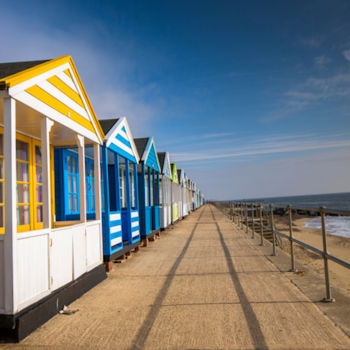 Beach huts on Southwold promenade in Suffolk during hte summer